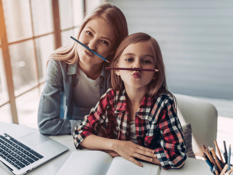 Featured image of young woman and daughter doing homework by 4PM Production via Shutterstock
