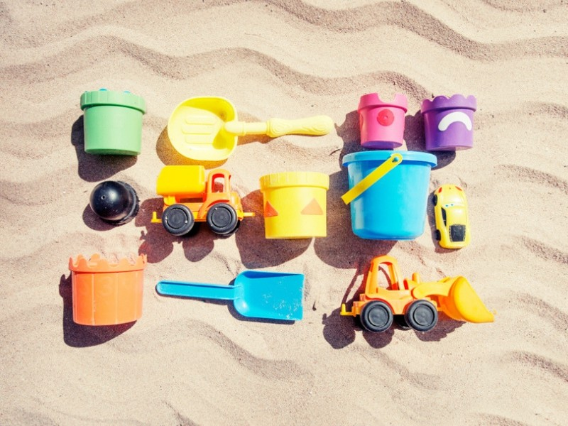 Beach Toys for Children laid out against the sand.