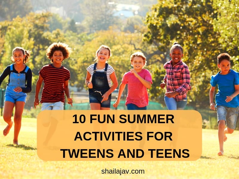 Tween kids running in a group towards the camera in an open field indulging in summer activities