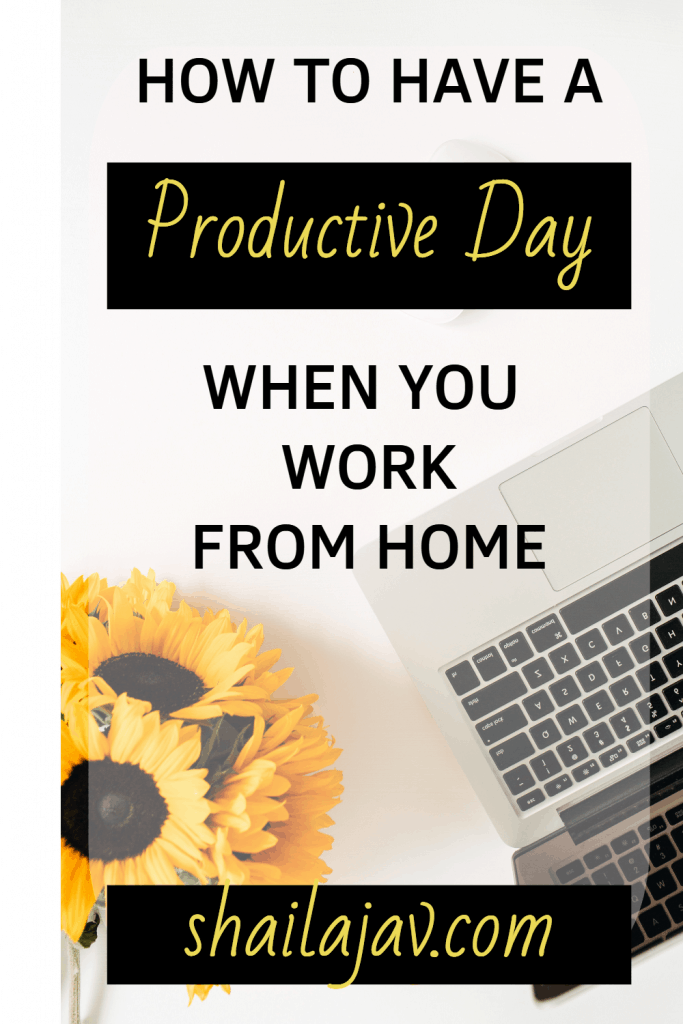 Laptop Flatlay with sunflowers talking about productivity tips.