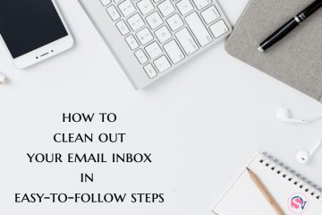 Desktop with a keyboard, a phone, a book and a pen laid out with tips on how to clean up your email inbox in simple steps
