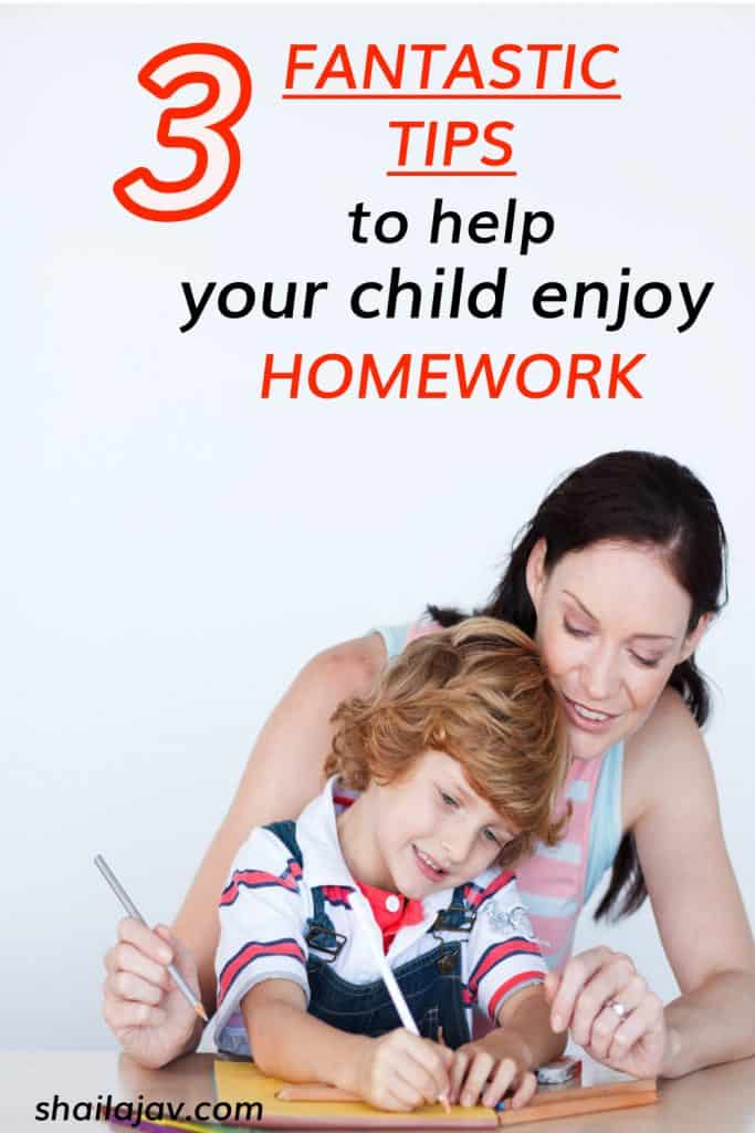 Mother and child smiling and sitting at a table and doing homework together.