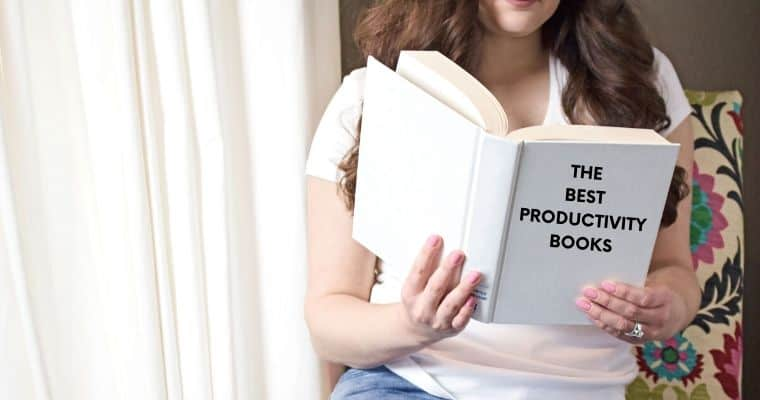 A woman reading a book the cover of which says 'The Best Productivity Books'