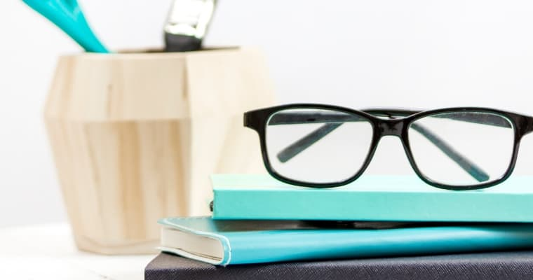 Books with glasses on top where the post talks about blogging for authors