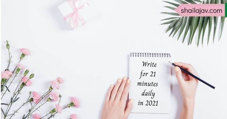 Pink flowers and leaves against a white background. Hand holding a pencil poised over a notepad with the text Write for 21 minutes daily in 2021