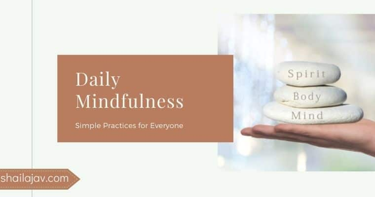 Hand holding stones with the words body, mind and soul written on them signifying daily mindfulness practices for a healthy mindset