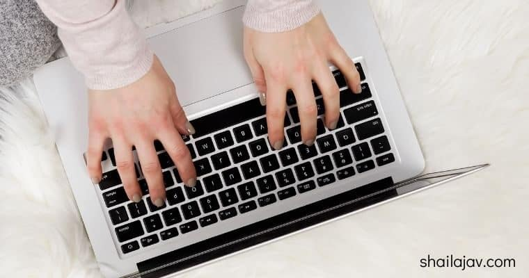 Woman hands typing on laptop - how to download IGTV video to your desktop
